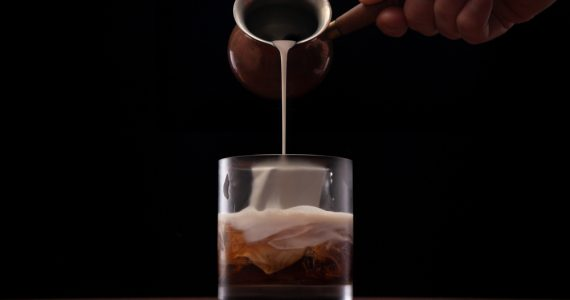 Bartender finishing a White Russian cocktail