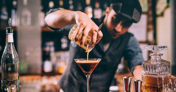 bartender pouring a martini