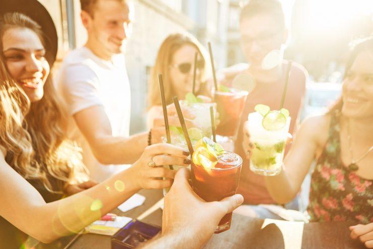 Friends enjoying refreshing cocktils during summer